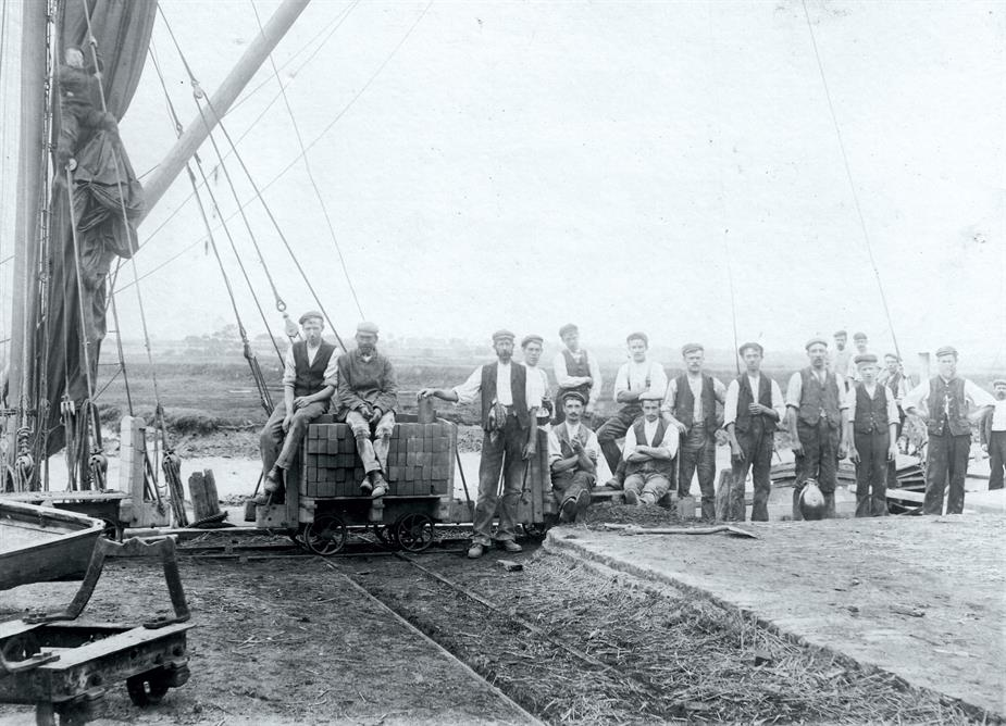 Loading Bricks onto Thames Barge for London